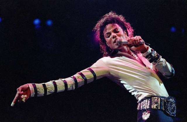 "© AP Photo/Cliff Schiappa, File FILE - In this Feb. 24, 1988 file photo, Michael Jackson leans, points and sings, dances and struts during the opening performance of his 13-city U.S. tour, in Kansas City, Mo. Jackson's ""Thriller…"