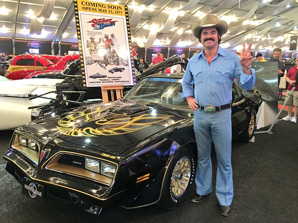 Burt Reynolds look a like with a Pontiac Firebird from Smokey and the Bandit